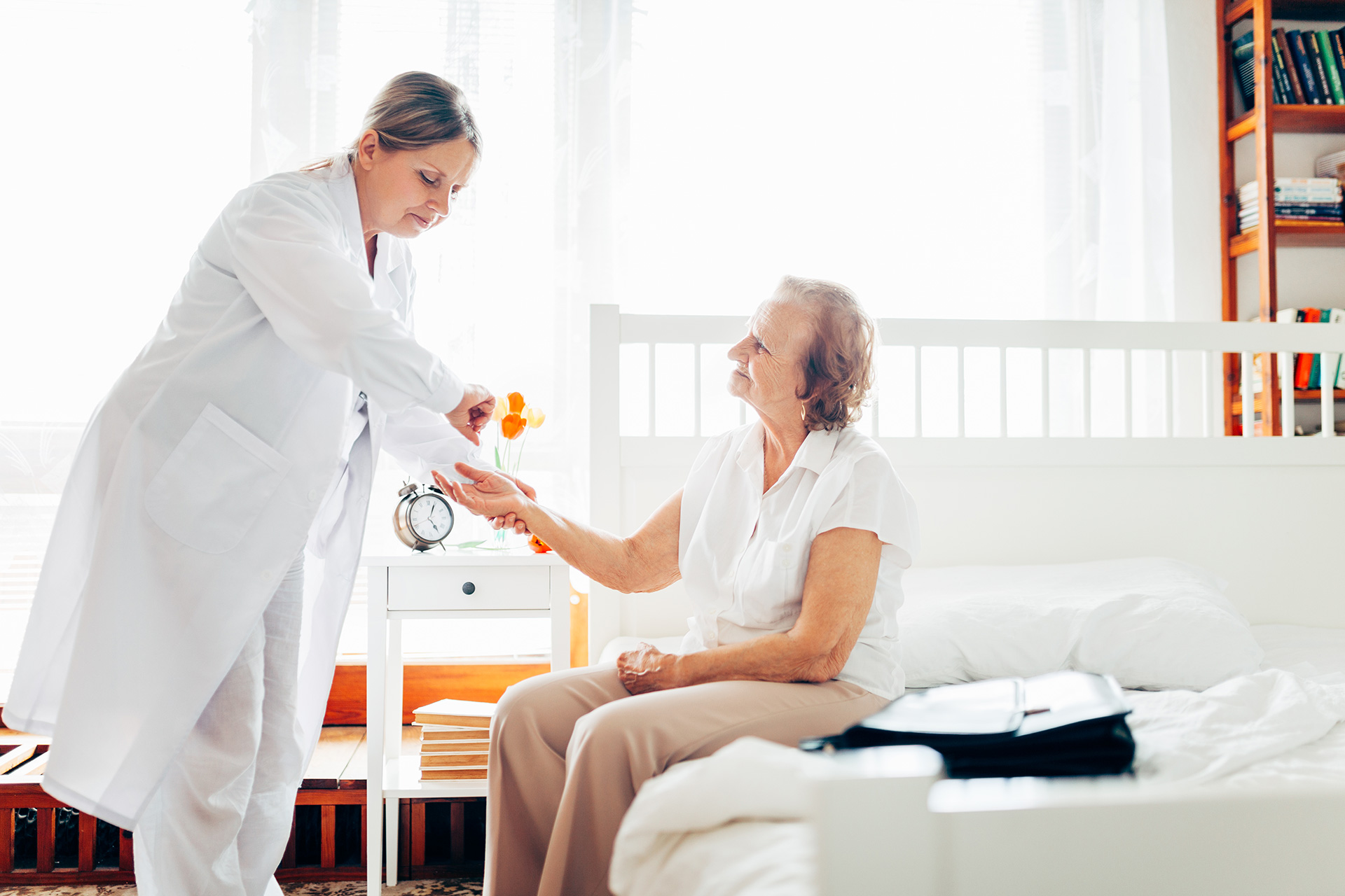 providing-care-for-elderly-doctor-visiting-P76YEJ6